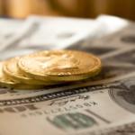 アメリカドルとコインの画像